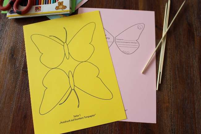 farbiges Tonpapier mit Schmetterlingen zum Ausschneiden