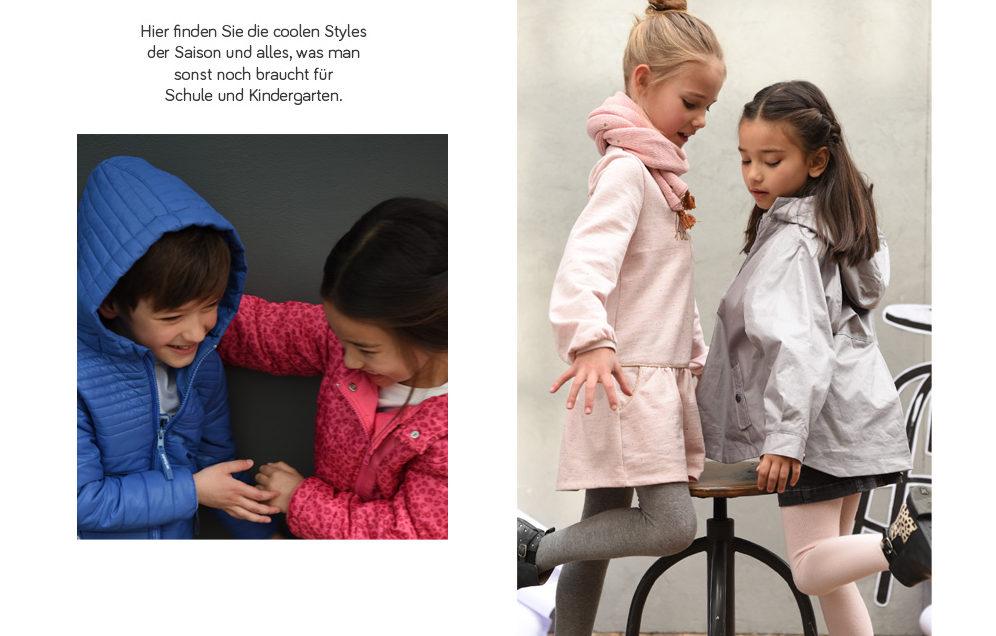 Kinder zeigen sich ihre neuen Outfits für die Schule